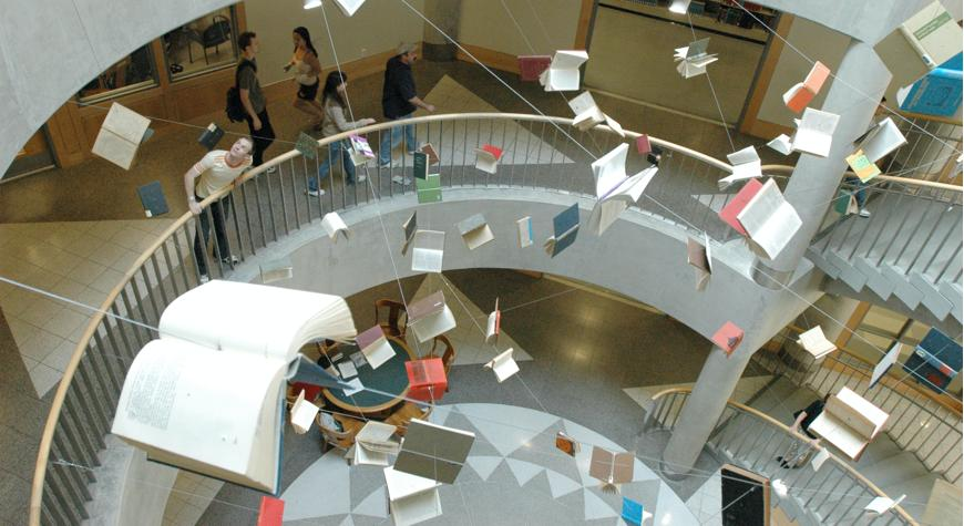 Books flying over a circular stairwell